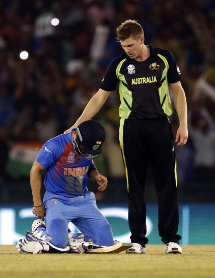 India's Virat Kohli (L) is congratulated by Australia's James Faulkner after India won the match. (REUTERS)